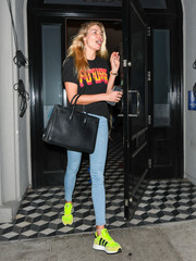 Jessica Hart brightened up her look with a pair of neon-yellow running shoes by Adidas.