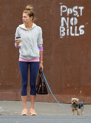 Jessica Hart did some colorful layering with a light gray hoodie, a purple sweater, and a pink shirt while out and about in Manhattan.