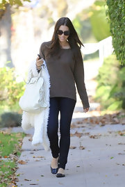 Jessica Biel kept her look simple in a  loose brown sweater and dark denim skinny jeans.