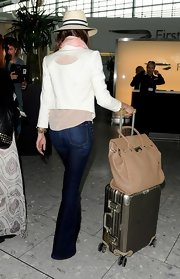 There couldn't possibly be a more perfect carry-on than Jessica Alba's beige tote.