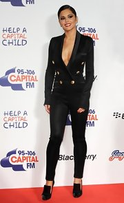 Cheryl Cole paired her Balmain jumpsuit with black, patent leather heels.