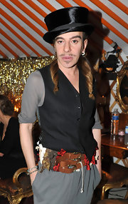 John Galliano paired his cool vest with a black top hat.