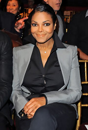 Janet Jackson showed off her short side part while hitting the John Galliano Fashion Show.