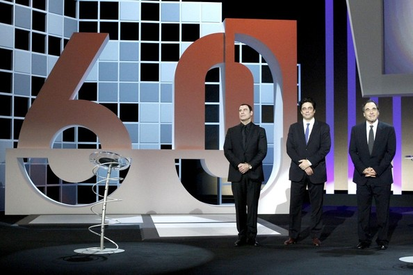John Travolta and Oliver Stone Collect Awards