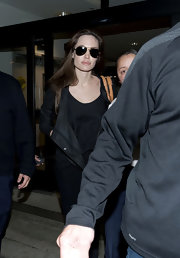 Anglina sported classic black aviators for her trip to LAX.