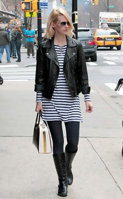 January Jones toughened up her striped dress with a moto jacket and leather boots.