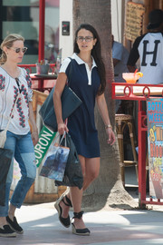 Jordana Brewster topped off her ensemble with an oversized teal shoulder bag.