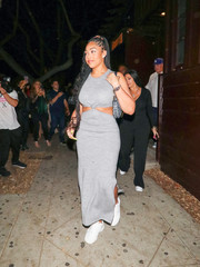 Jordyn Woods chose a pair of white sneakers to finish off her look.