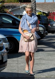 Julianne Hough styled her pink dress with a voluminous blue scarf while out and about in Beverly Hills.