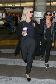 Julianne Hough sported an all-black pants, tank top, and cardigan combo during a flight to LAX.
