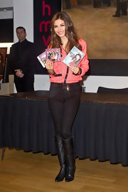 Victoria Justice kept her pink blouse the focal point of her look by pairing it with belted black skinny jeans and matching boots.