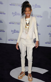 Willow Smith paired her architectural ivory suit with flat colorblock wedges.
