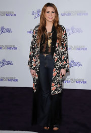 Miley was in a retro mood at the 'Justin Bieber: Never Say Never' premiere in a floral fringed evening coat.