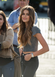 Kaia Gerber accessorized with a chic silver quartz watch while visiting 'Extra.'
