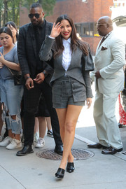 Olivia Munn was spotted outside the Build headquarters rocking a gray short suit by Teresa Helbig.