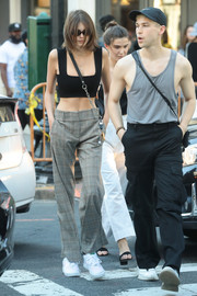 Kaia Gerber flaunted her tiny waist in a black crop-top while out and about in LA.