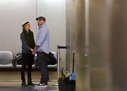 Josh Resnik wore Nike sneakers and classic jeans while traveling with Kaley Cuoco.