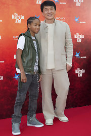 Jaden paired his leather vest with a cool pair of grey high top sneakers.