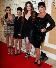 Kris Jenner wore a black beaded evening dress with ultra sparkled for the Kardashian store opening.