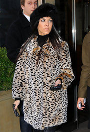 Kourtney completes her fur ensemble with a warm winter fur hat.