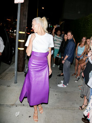 Karlie Kloss wore a Salvatore Ferragamo A-line leather skirt in a dazzling purple hue while enjoying a night out in LA.