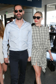 Kate Bosworth accessorized with a pair of angular shades by Celine for a flight out of LAX.
