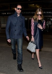Kate Bosworth topped off her airport look with a monochrome printed tote.
