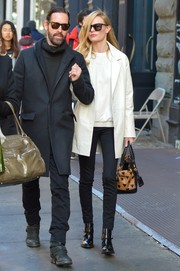 Kate Bosworth stepped out in New York City looking stylish in a white coat and black skinny jeans.