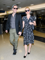 Kate Bosworth was spotted at LAX looking demure in a fireworks-print midi dress by HVN.