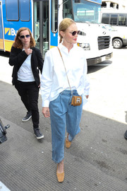 Kate Bosworth caught a flight out of LAX wearing an oversized white button-down by Toteme.