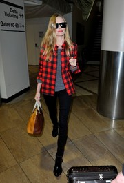 Kate Bosworth chose a stylish tricolor leather tote for her hand-carry bag.