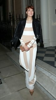 Florence looked charmingly elegant in this nude and white striped number.
