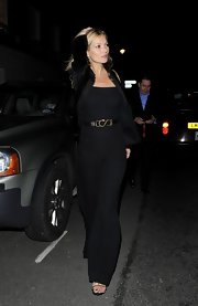Only Kate Moss could make a jumpsuit look this stunning. We loved the streamlined silhouette and unique belt.
