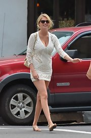 Kate Upton chose a sexy but relaxed crocheted mini dress for her daytime look while out in NYC.