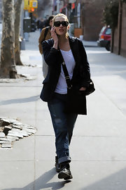 Actress Kate Winslet is seen out and about in West Village chatting on the phone. She tops her New Yorker style off with a black leather messenger bag.