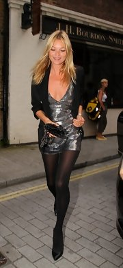 Supermodel Kate Moss pairs her sexy chic metallic minidress with simple black pumps.