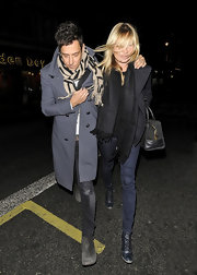 Kate Moss kept cozy in a wool coat paired with leather lace-up boots.