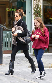 Kate Beckinsale was out and about town with daughter Lily in black tights paired with black leather boots complete with buckled detailing.
