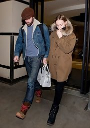 While arriving at LAX, Michael Polish was spotted wearing a cool denim jacket with fur trim.