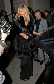 Kate donned a fur bordered shawl with her black leather clutch and loose sleek black pants.