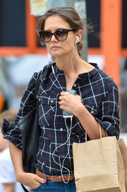 Katie Holmes stepped out in New York City wearing a pair of classic cateye sunnies by Stella McCartney.