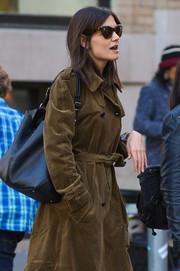 Katie Holmes paired a black leather bag with a corduroy trenchcoat for a day out.