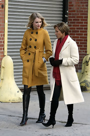 During an interview with Katie Couric, Taylor stayed stylish in Louboutin's Alti Botte platform boots.