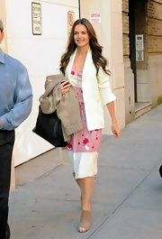 Katie Holmes ran errands in a feminine ensemble, layering a white boyfriend blazer of a girlish pink print frock.