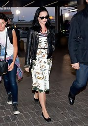 Katy Perry chose a cool leather jacket to pair over her printed frock for a cool mix of textures.