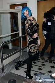 Katy Perry arrived at BBC Radio 1 wearing a pair of black leather ankle boots with stiletto heels.