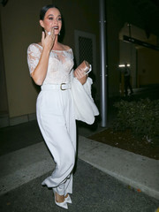 Katy Perry matched her chic top with a pair of white silk pants, also by Ryan Roche.