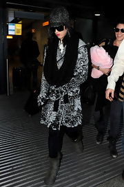 Katy Perry nixes the cold weather in gray sheepskin boots.
