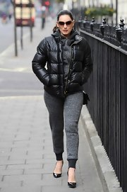 Kelly Brook sported a casual tweed jumpsuit while out and about in London.