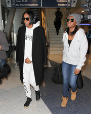 Kelly Rowland pulled her sporty look together with a pair of woven sneakers.